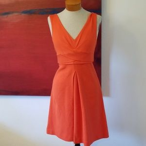 Orange anthropologie fit and flare dress